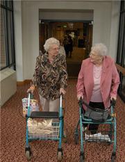 two elderly women taking a walk