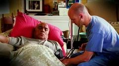Nurse taking patient BP