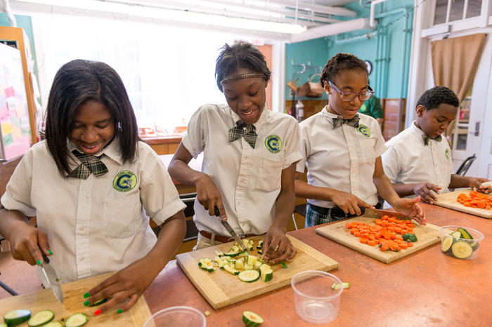 Girls chop vegetables in New Orleans