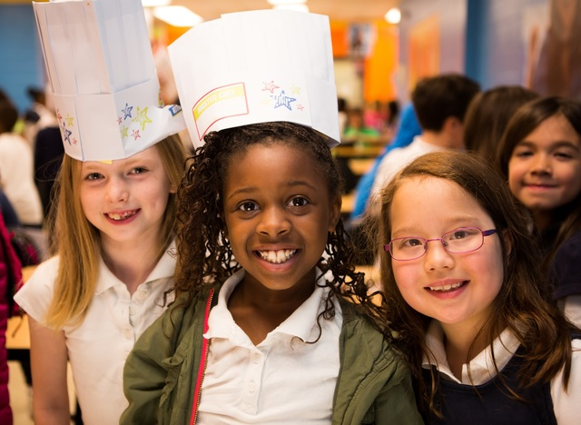Three girls with chef hats at Chicago Public Schools