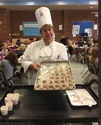 Chef providing student's a taste test
