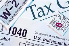 a montage of income tax-related items including a form 1040, for w2, and a calendar with april 15 highlighted