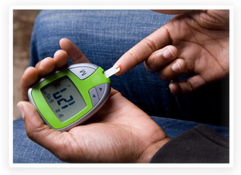 A person with diabetes tests blood sugar