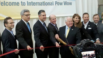 Under Secretary of Commerce for International Trade Francisco Sanchez cuts the ribbon to open Pow Wow 2012 with Travel and Tourism officials