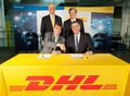 Under Secretary S�nchez and the CEOs of DHL celebrate their new partnership