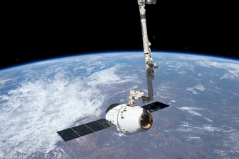 View from the International Space Station of the SpaceX Dragon spacecraft as the station�s robotic arm moves Dragon into place for attachment to the s