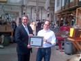 Under Secretary Francisco Sánchez presents Nikolas Weinstein of Nikolas Weinstein Studios an Export Achievement Certificate at his studio in San Franc