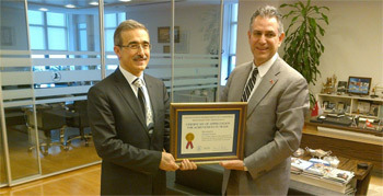 Under Secretary Sanchez (right) presents a Certificate of Appreciation for Achievement in Trade to Ismail Demir, General Manager and Deputy Chairman o