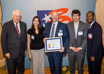 Rep. David Price of North Carolina presented Urban Planet Mobile with an Export Achievement Certificate.