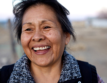 Photo of an older woman smiling.