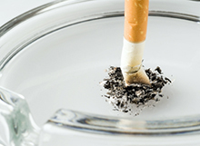 Photo of a cigarette stub in an ashtray.