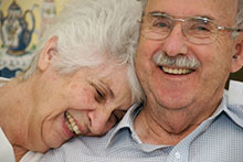 Smiling older couple.