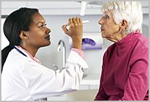 Senior woman getting an eye exam.