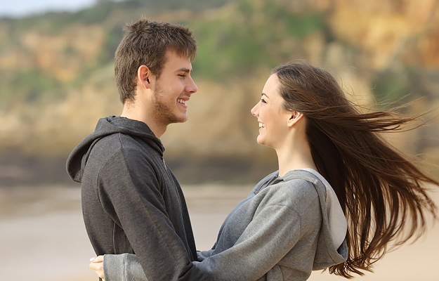 A smiling couple in a healthy romantic relationship.