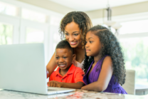 Mother and children using a laptop computer