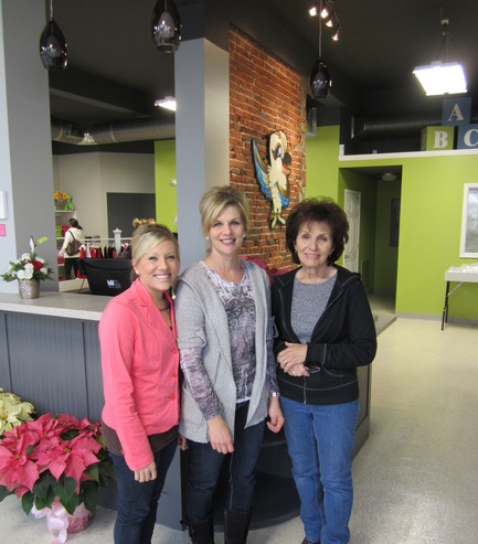 Glenda Aschoff (right) poses with her daughter, Julie Weidner (center), and granddaughter, Katie (left), on the sales floor of Kookaburras Kloset.