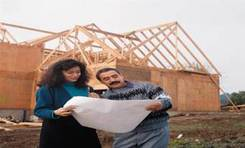 Image of a woman and man working on a construction project