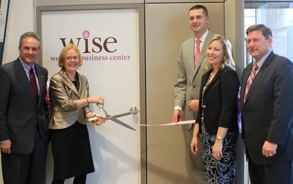 WISE Women's Business Center Director Joanne Lenweaver (second from left) cuts the ribbon to unveil the center's new space at The Tech Garden.