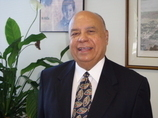 District Director, Wilfredo J. Gonzalez