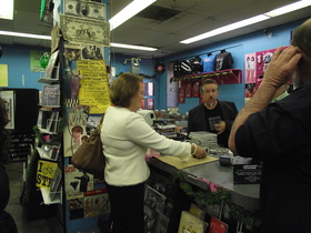 Administrator Mills purchases album at Vintage Vinyl
