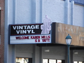"Vintage Vinyl's marquee states ""Welcome Karen Mills S B YAYY!"