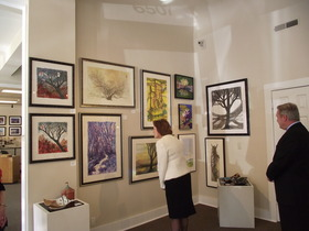Mills and Melton admire artwork at Compônere