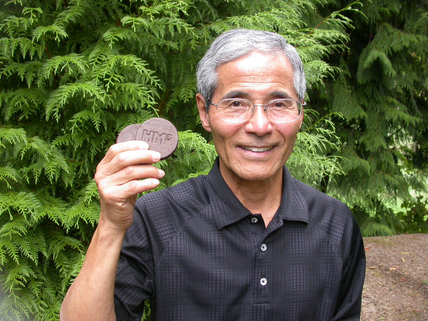 Hiroshi Morihara holding HM3 Energy's TorrB Briquettes