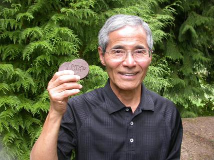 Hiroshi Morihara holding HM3 Energy's TorrB Briquettes