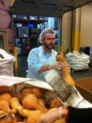 Lender Relastions Specialist Scott Bossom inspects squash at the Oregon Food Bank
