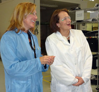 Administrator Karen Mills with Rebecca Ufkes at UEC Electronics
