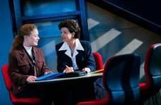 Image of two women talking