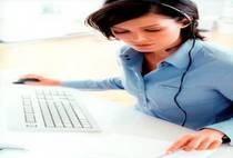 Image of woman working on desk