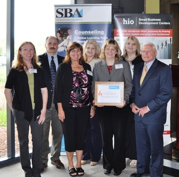 Lorain County Community College SBDC staff with Director Kimberly Plzak (holding award) and SBA District Director Gil Goldberg