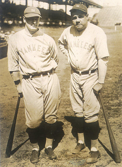 Babe Ruth on the baseball field with a teammate