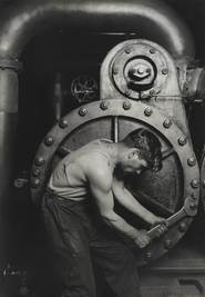 A black and white image of a man operating machinery