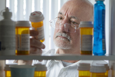 Man looking at prescription drugs
