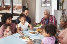 Family Enjoying Meal Around Table