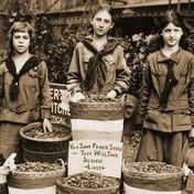 Girls collecting peach pits used in gas mask production