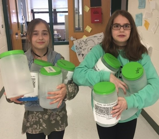 2 girls holding buckets for poptops
