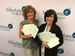 Foundation staff with grant checks