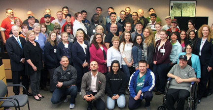 Mayor Nicola Smith and Chief Steven J. Jensen (left, second row) stand alongside the 2014 Lynnwood Police Citizens Academy graduates as they pose recently for a photo in the Lynnwood Municipal Court