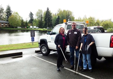 Mayor Smith, Jeff Persons from Parks Operations, and volunteer Stephanie Brown kick off an Earth Day clean-up project at Sprague's Mini Park and Scriber Creek Trail.
