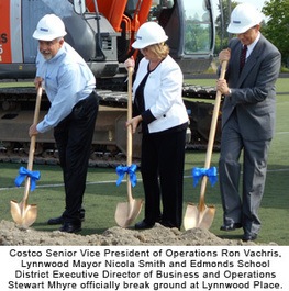 Costco Senior Vice President of Operations Ron Vachris, Lynnwood Mayor Nicola Smith, and Demonds School Disctrict Executive Director of Business and Operations Stewart Mhyre officially break ground at Lynnwood Place