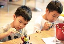 Children painting ceramics