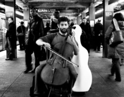 Man playing cello in subway station