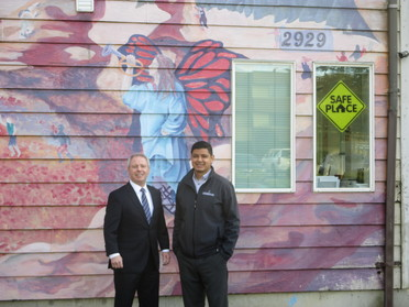 """Terry and Julio on the side of the complex.  Cocoon House is a designated """"Safe Place"""" for youth in need."""
