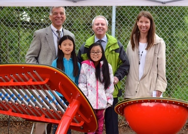 Terry with students and new outdoor musican instruments