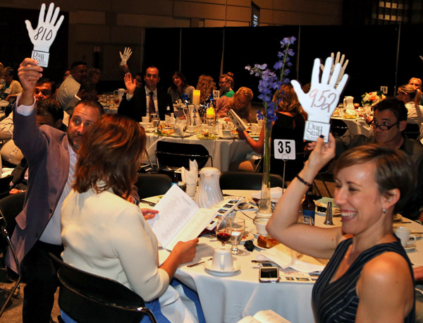 bidders at the Jackson National Life table during Wednesday evening's auction