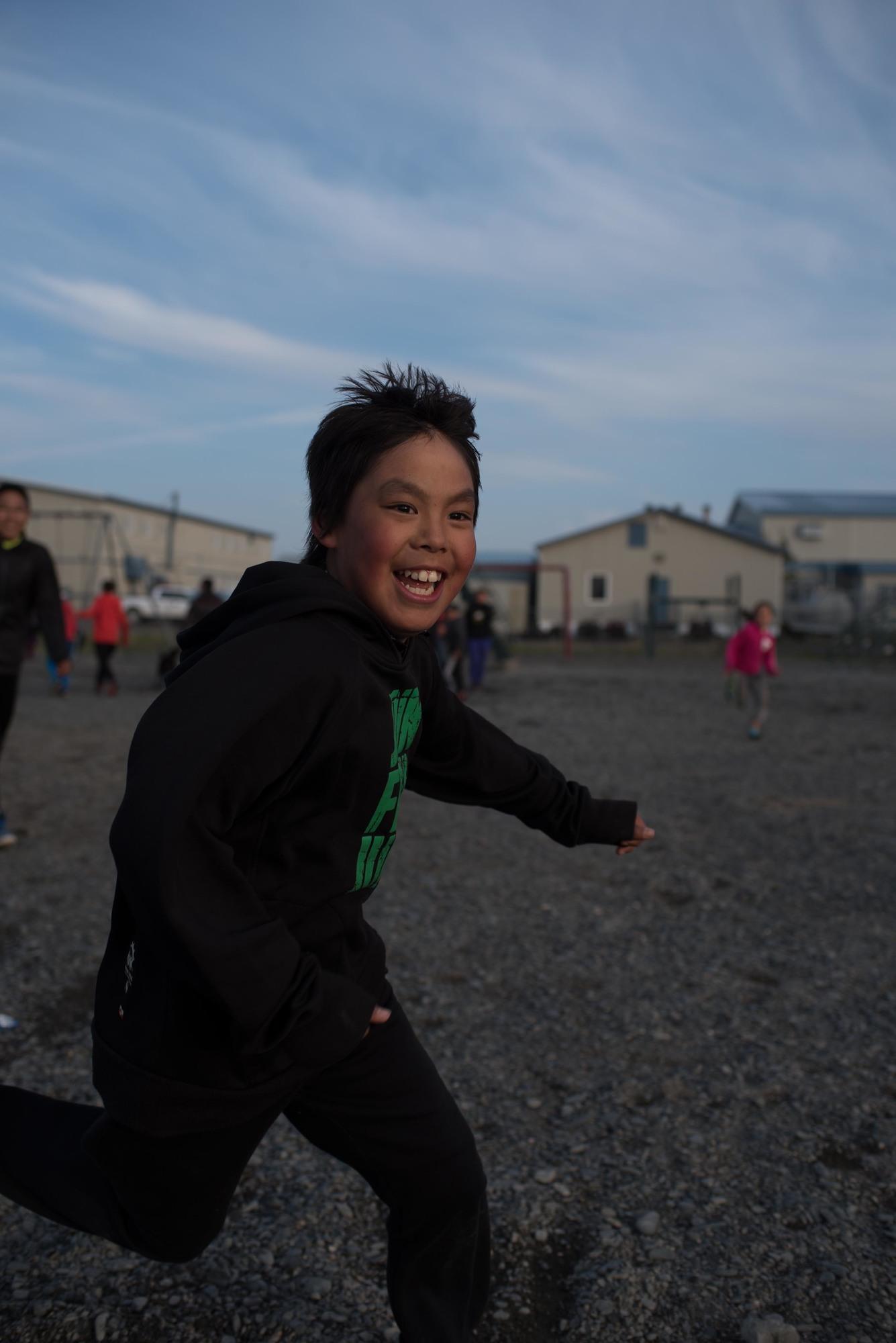 Alaska child playing outside at school