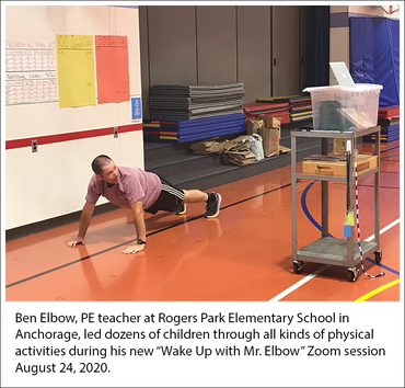 """Ben Elbow, PE teacher at Rogers Park Elementary, Anchorage, leads class through exercises on """"Wake Up with Mr. Elbow"""" Zoom session 08/24/20"""